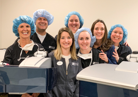 Des Moines LASIK surgeon, Dr. Matthew Rauen, with nurses and clinical staff at Wolfe Surgery Center in Des Moines, Iowa.