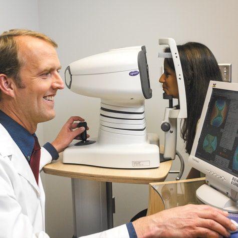 Ames LASIK specialist, Dr. Louis Scallon, performs cornea topography test during LASIK consultation at Wolfe Eye Clinic.