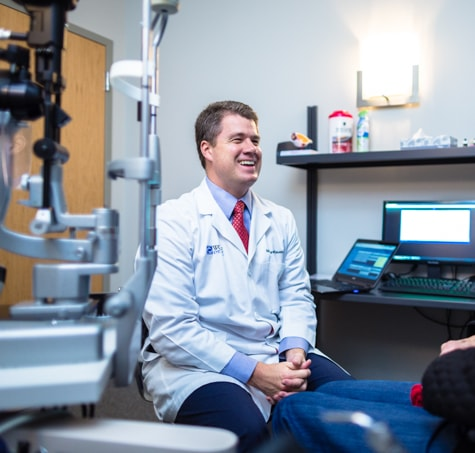 Dr. Matthew Rauen, Wolfe Eye Clinic LASIK surgeon, meets with LASIK patient to discuss vision and LASIK candidacy.
